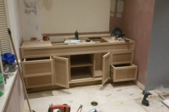 Work-in-progress build-in bespoke fully fitted TV stand by Construction Bear
