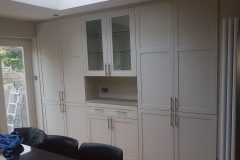 Completed build-in bespoke fully fitted wardrobe with bookshelves by Construction Bear