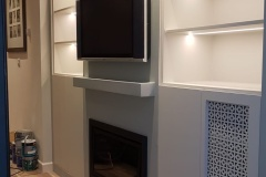 Completed build-in bespoke fitted storage with bookshelves by Construction Bear
