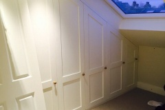 Loft bespoke build-in fitted storage units by Construction Bear