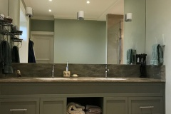 Build-in bespoke fully fitted bathroom unit with shelves/bathroom wardrobe by Construction Bear