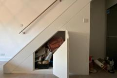 Under the stairs fully fitted furniture storage units by Construction Bear